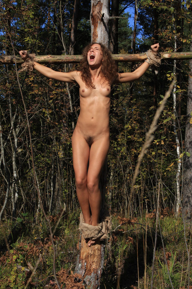 naked-women-crucified-in-forest